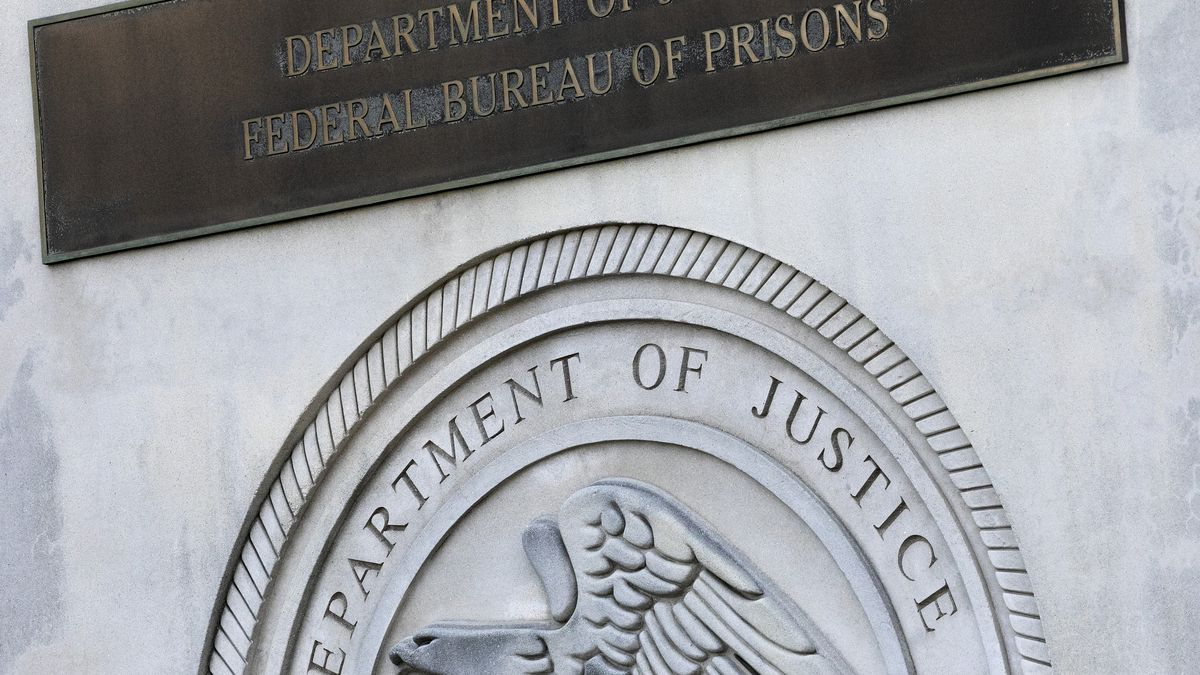 In this July 6, 2020, file photo a sign for the Department of Justice Federal Bureau of Prisons...