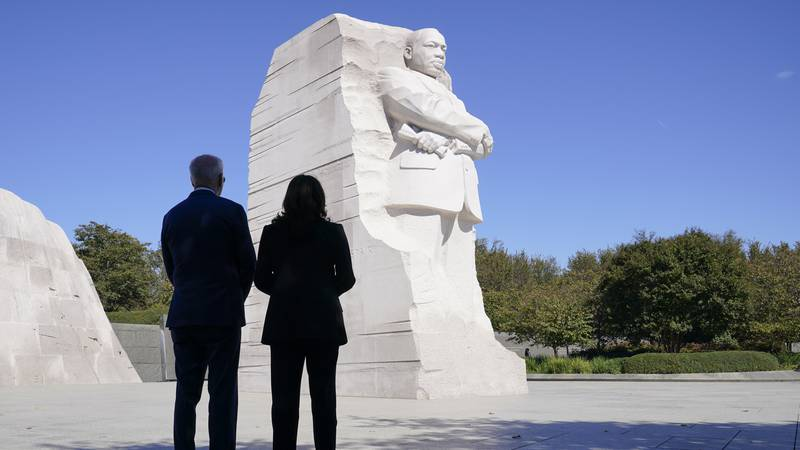President Joe Biden and Vice President Kamala Harris stand together at the Martin Luther King...