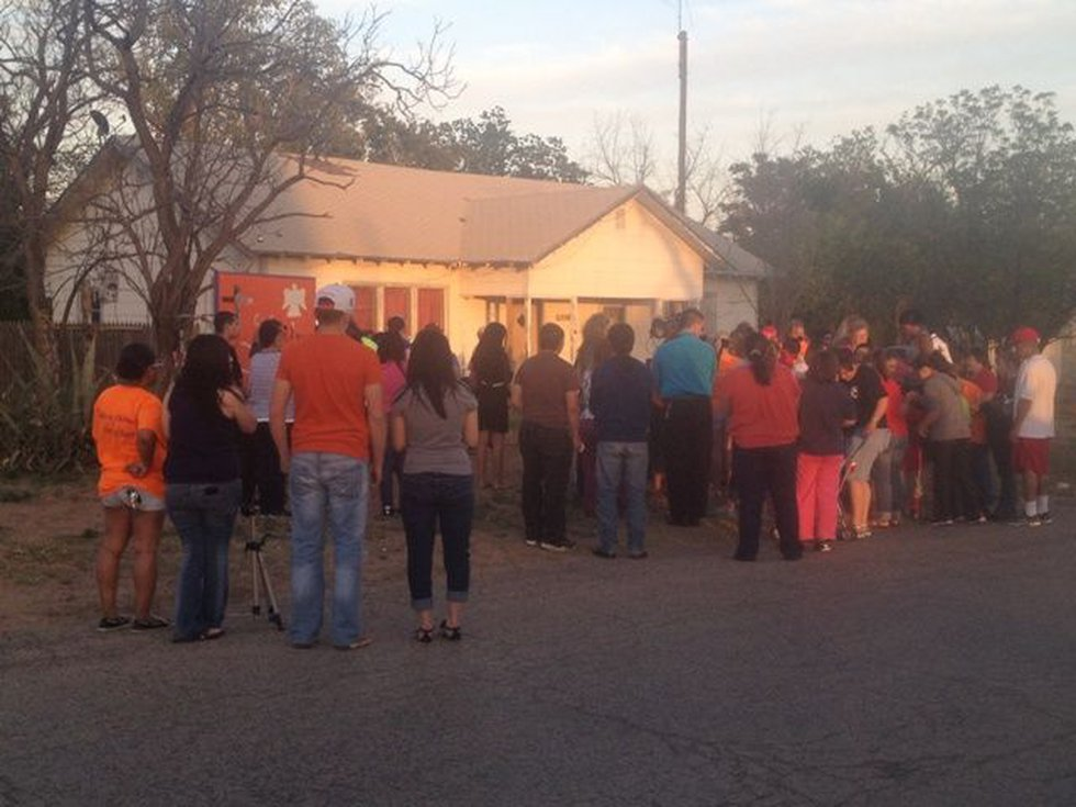 Friends gather for candlelight vigil in front of Dunn house.