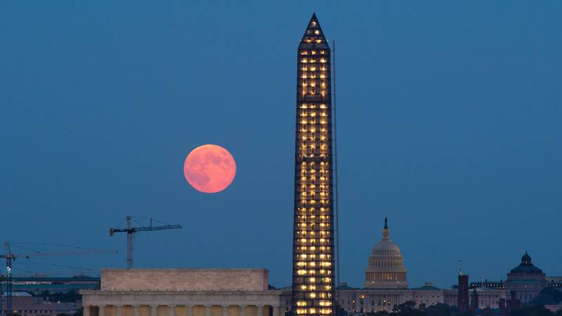 A full moon, known as a Harvest Moon, rises over Washington, Thursday, Sept. 19, 2013, in...