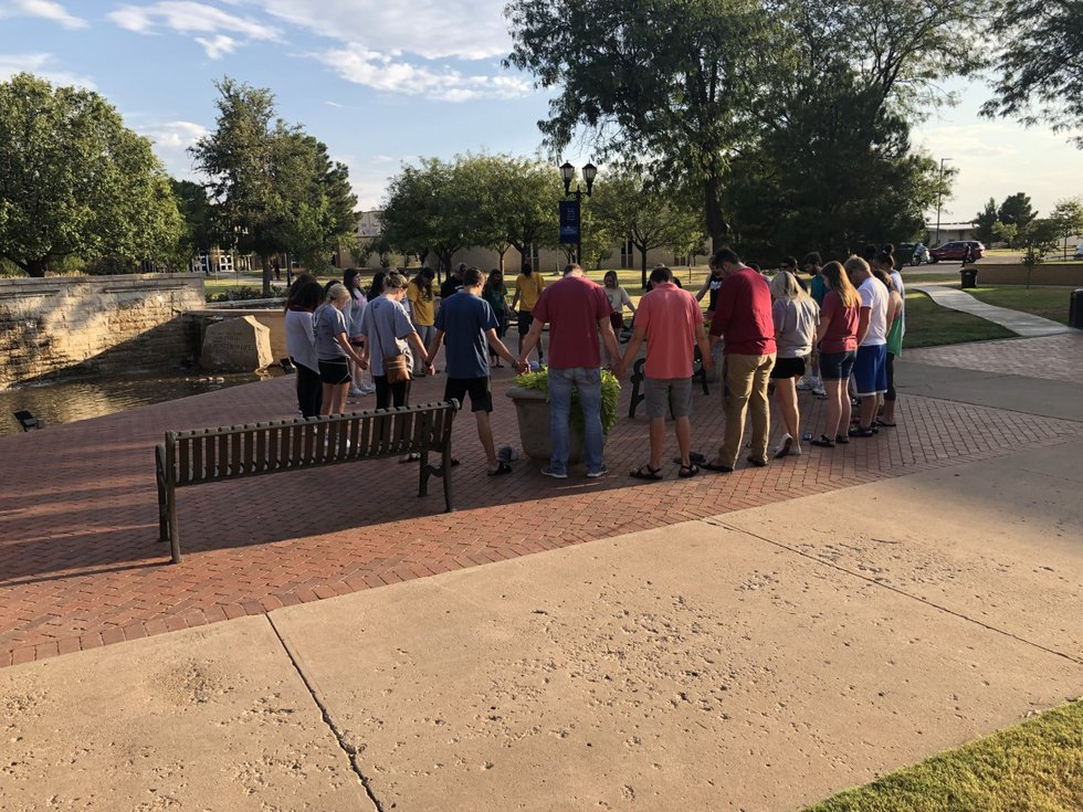 Students from Lubbock Christian University gathered on campus on Aug. 31 to pray for victims of...