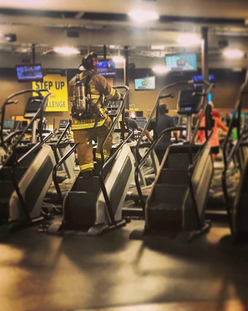 Local firefighters in full gear complete the Crunch Fitness 9/11 Remembrance Climb every year.