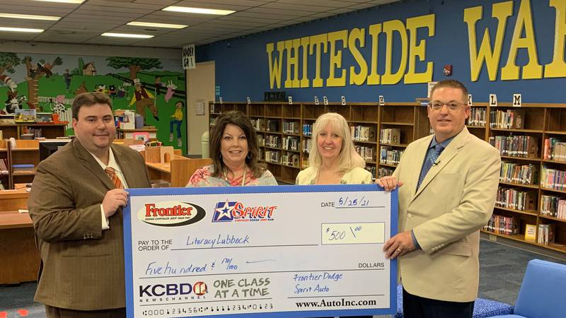 Frontier Dodge and Spirit Chrysler present a check to Literacy Lubbock, the charity chosen by...