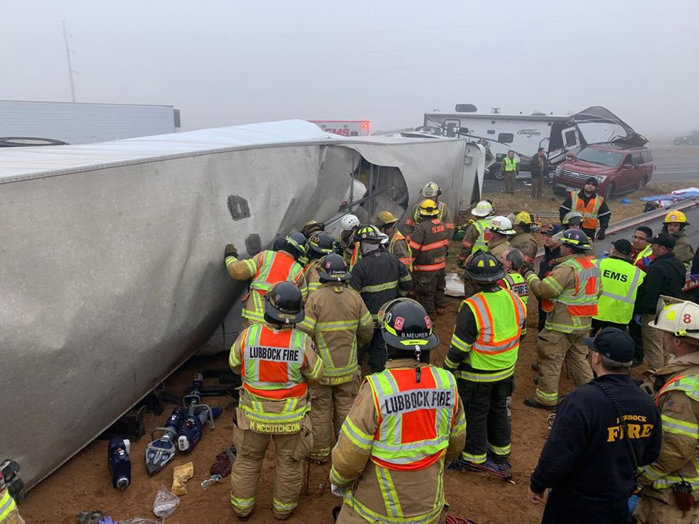 Members with the Lubbock Fire Department help out with a series of crashes east of Slaton on...