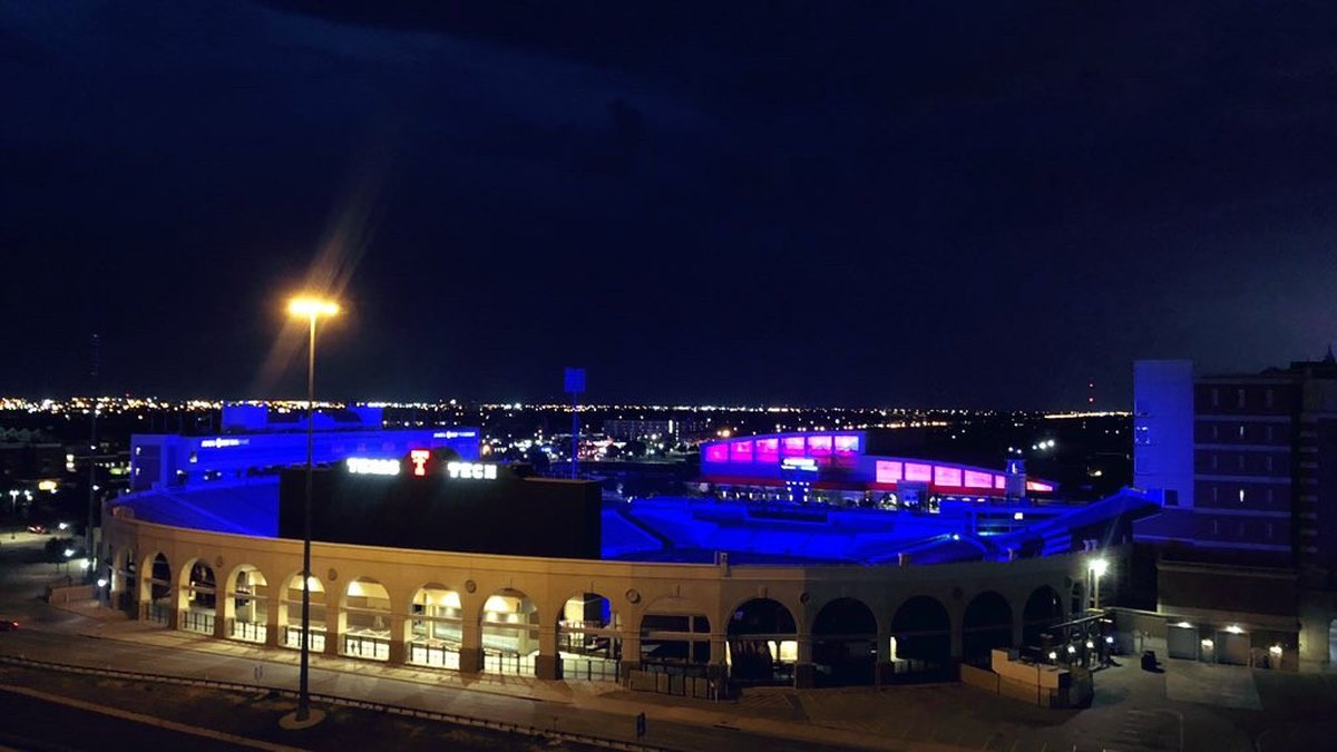 Jones AT&T Stadium lit up in blue to honor fallen LSO SWAT Leader Josh Bartlett.