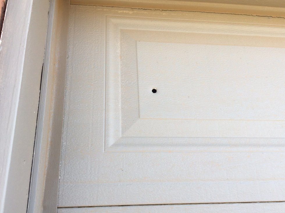Bullet holes can be seen at the house where the drive-by shooting took place (Source: KCBD)