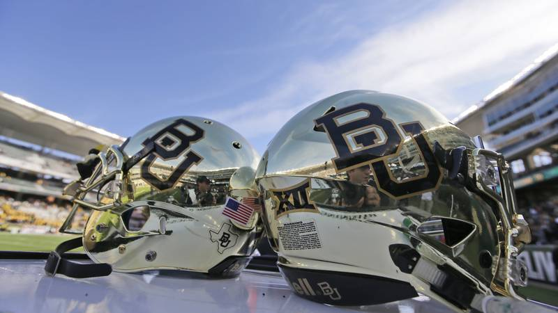 FILE - In this Dec. 5, 2015 file photo, Baylor helmets are shown on the field after an NCAA...