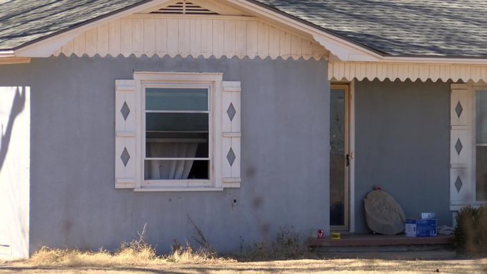 Authorities say someone set a fire in this house to cover the murder (Source: KCBD)