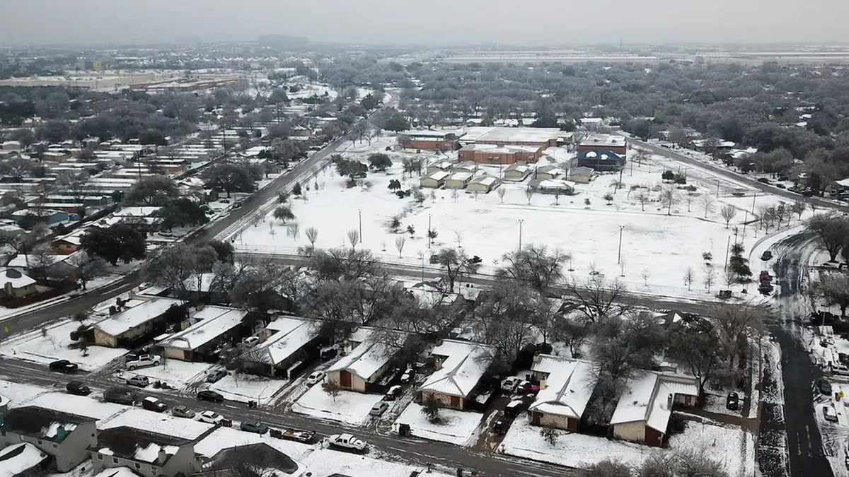 An aerial view of the Dove Springs neighborhood in South Austin after a severe snowstorm dumped...