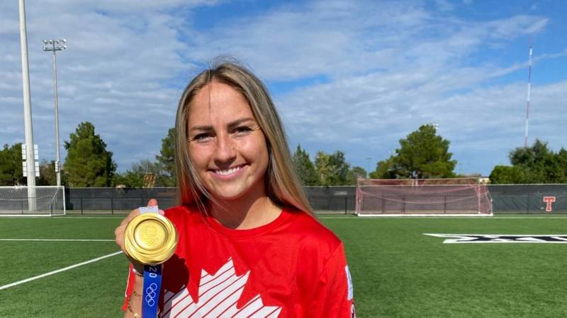 About a week after she won an Olympic gold medal with Canada, Janine Beckie returned to Texas...