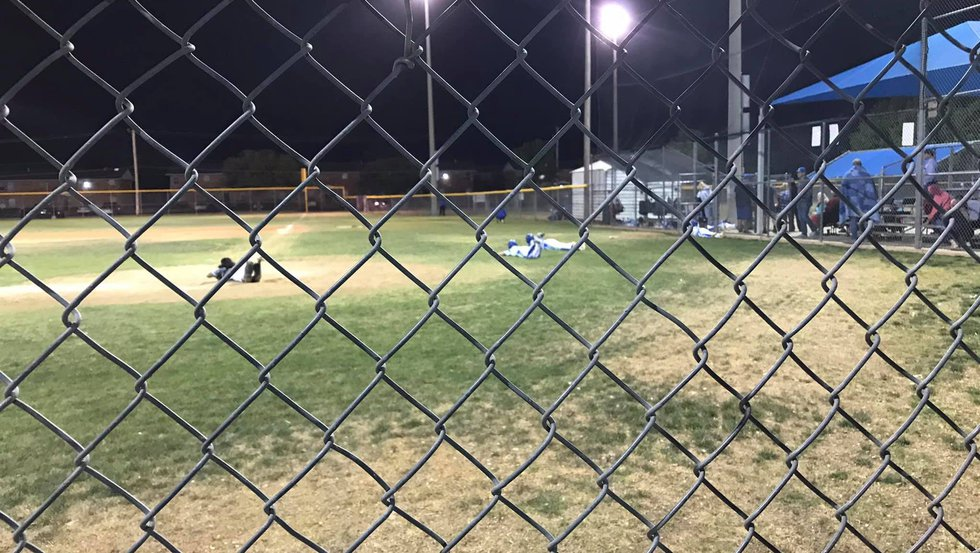 """""""Boys on the field were all laying on the ground. Some were army crawling to the dugout. The..."""