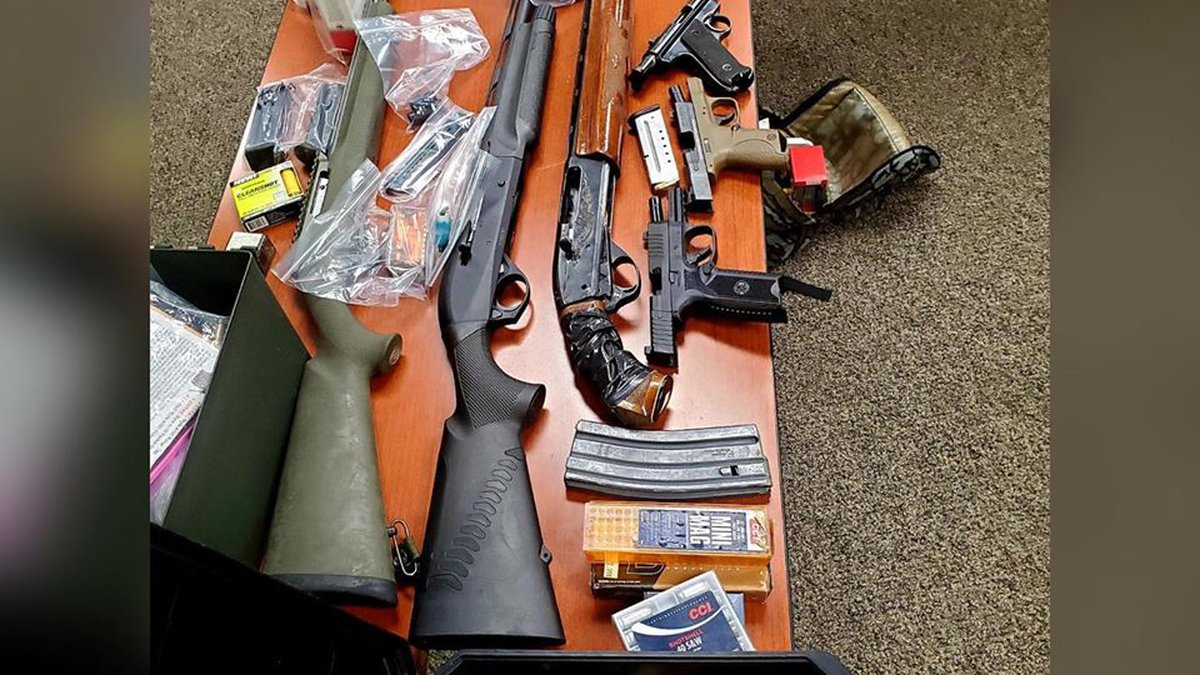 Several stolen and illegally modified firearms were seized during the search warrant