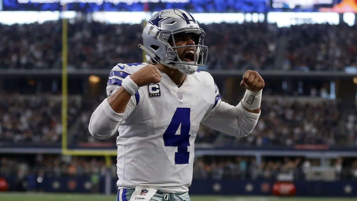 Dallas Cowboys quarterback Dak Prescott (4) celebrates scoring a touchdown on a running play in...