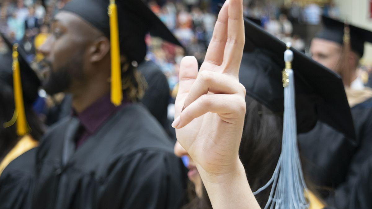 """WBU Graduation"" Wayland graduates participate in the school song during a graduation ceremony..."