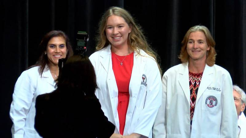 First-year medical students receive their white coat from the Texas Tech Health Sciences Center...