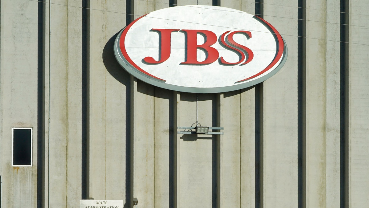 FILE - In this Oct. 12, 2020 file photo, a worker heads into the JBS meatpacking plant in...