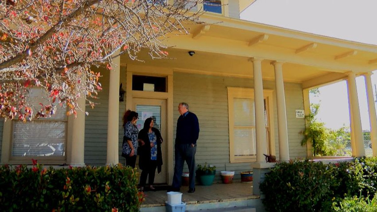Individuals helped by Family Promise stands at the Hope House. (Source: KCBD)
