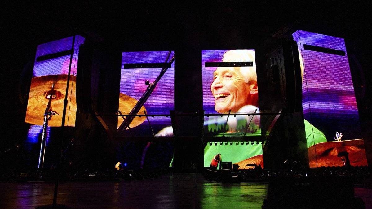 """A video tribute to Charlie Watts plays before the Rolling Stones perform during the """"No Filter""""..."""