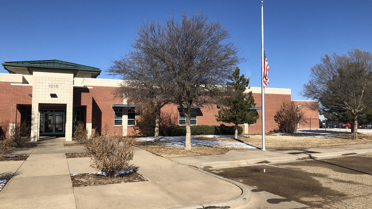 The flag in front of the Lubbock Fire Department headquarters is flown at half-staff after the...
