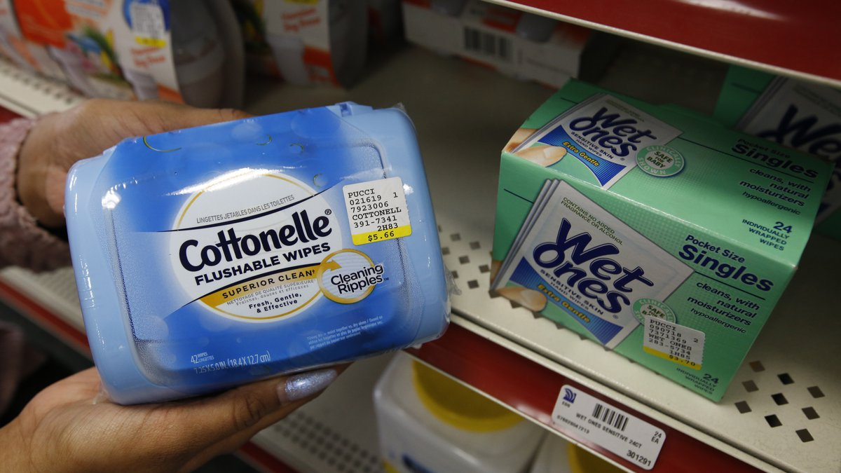 Alice White displays a package of Cottonelle single use flushable wipes at Pucci's Leader...
