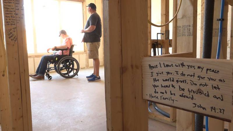Dawson watched as friends, family, and sponsors all took pen to wood, writing notes of...