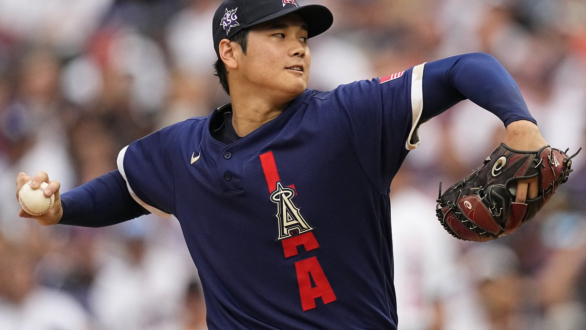 American League's starting pitcher Shohei Ohtani, of the Los Angeles Angels, throws during the...