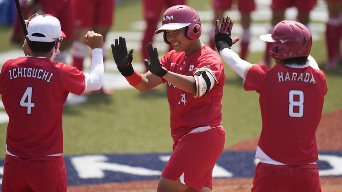Japan's Minori Naito, center, celebrates with her teammates after hitting a two run home run...