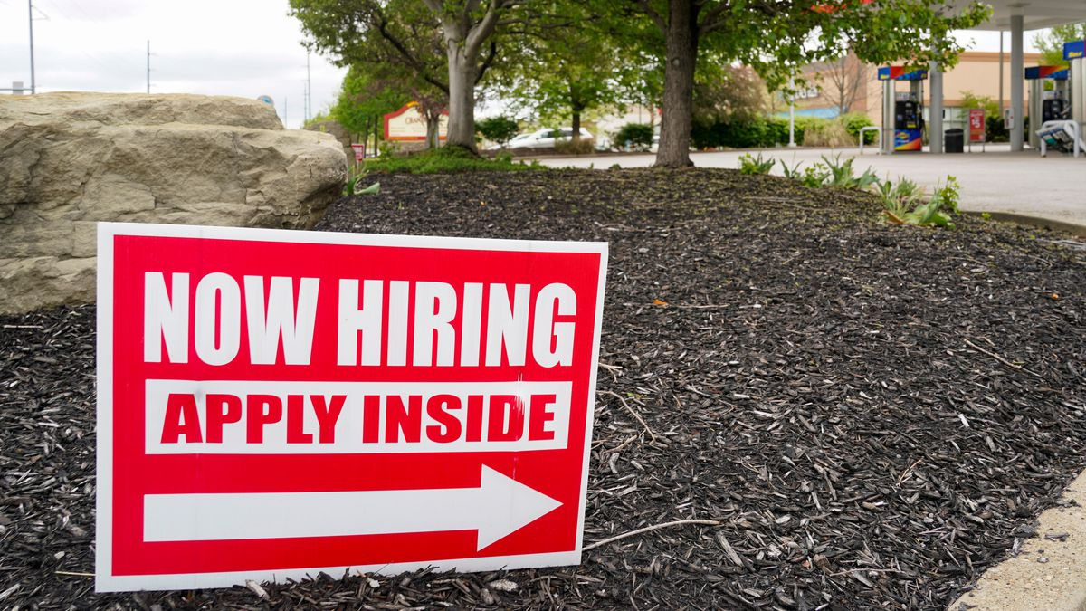 FILE - Hiring signs are posted outside a gas station in Cranberry Township, Butler County, Pa.,...