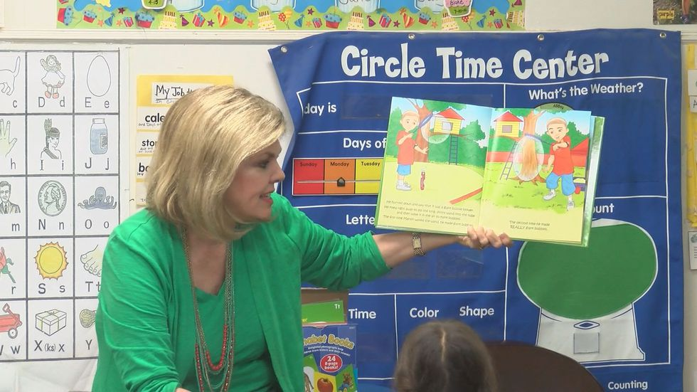 Happy State Bank's Craig Wells and KCBD's Karin McCay teamed up to give children at Talkington...